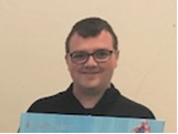 Service user Aaron with cream background
