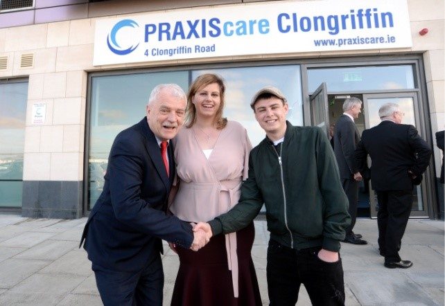 Minister of State of Disability Services, Finian McGrath shaking hands with Jordan Taaffe with women standing in between outside Praxis Clongriffin building.