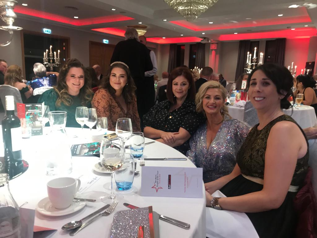 group of ladies at dinner table at award ceremony